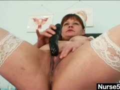 Fat body nurse stuffs toy into her cunt movies