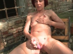 Mature redhead sits outdoors and toys her cunt movies at lingerie-mania.com