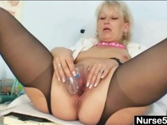 Solo mature nurse stuffs speculum in her pussy videos