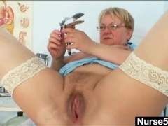 Chubby old babe in glasses toys her pussy movies at lingerie-mania.com