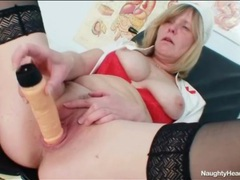 Mature chick in nurse uniform has perky tits movies at freekilomovies.com