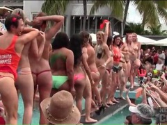 Lots of topless amateur hotties at a pool party tubes