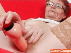 Redhead granny with hairy pussy fucks a toy videos