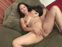 Lusty babe moans as she masturbates solo videos