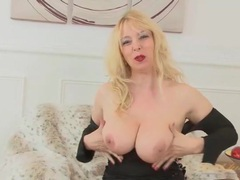 Milf in a tight black dress exposes her big tits videos
