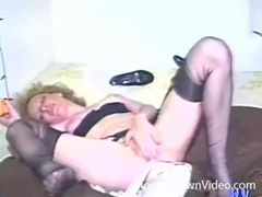 Vintage hairy girl in stockings fucks a toy tubes