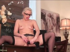 Hot blonde in glasses sits on a black dildo movies at kilopills.com