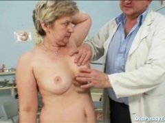 Shaved granny toys her pussy as doctor watches videos