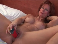 Red dildo slides deep into her milf hole videos