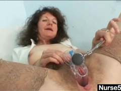 Cunt close up with the speculum inside it videos