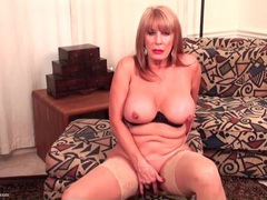 Big boobs solo mature masturbates in stockings videos