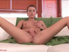 Skinny babe with a pierced belly button plays solo movies at freekiloporn.com
