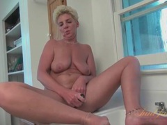 Saggy tits old lady fucks a toy into her tight cunt videos
