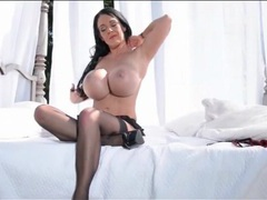 Babe with giant fake tits teases her sexy stockings videos