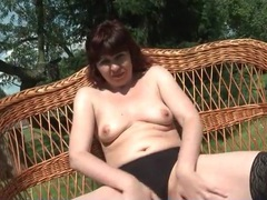 Outdoor striptease from big ass mature redhead videos