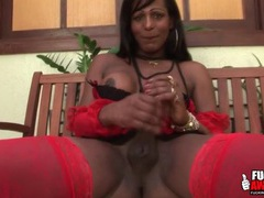 Red lingerie is dazzling on a black shemale videos