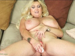 Her huge mature tits are tasty in a toy scene movies at lingerie-mania.com