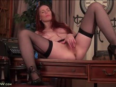 Redheaded milf temptress in sexy stockings videos