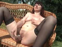 Milf in the sun dildo fucks her pretty pussy videos