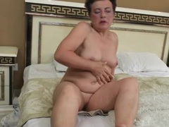 Old chick is horny and alone so she fingers her cunt videos