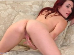 Redhead in lace trim panties fingers her pussy movies