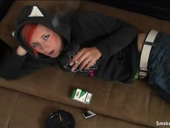 Punk chick in a flirty hoodie smokes a cigarette movies at kilopills.com
