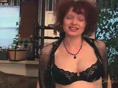 Cute mature redhead fondles her big tits videos