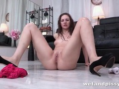 She pisses on the floor and fingers solo videos