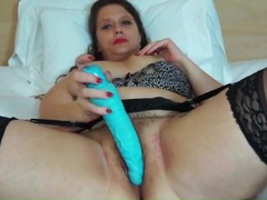 Dildo sensually pleasures her hairy mature pussy videos