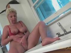 Granny gives up washing dishes to masturbate movies at lingerie-mania.com