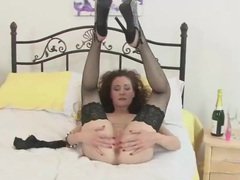 Lace top fishnets are dazzling on a solo milf videos