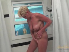 Granny drops her satin robe and takes a sexy shower tubes