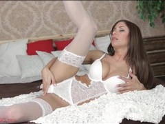 Dreamy white lace lingerie on a babe in bed movies at lingerie-mania.com
