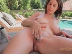 Mom with truly perfect big tits relaxes poolside movies at sgirls.net