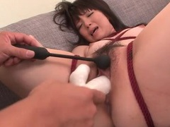 Tied up japanese cutie filled with a dildo tubes at japanese.sgirls.net