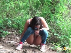Cute girl on a hike pees by the river videos