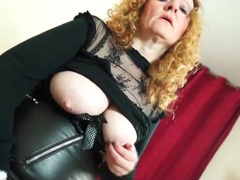 Slutty leather and fishnets on a mature redhead movies at sgirls.net
