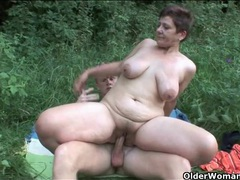 Sex in a grassy field with a naughty old lady clip