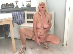 Naked old lady in stockings fucks her dildo videos