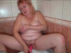 Pink haired granny pleasures her pussy in the shower movies at kilotop.com