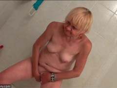 Granny in the shower has a sexy shaved pussy videos