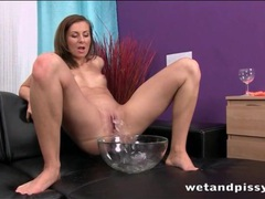 Pissing in a bowl and soaking her feet in it movies at sgirls.net