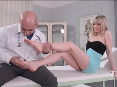 Doctor tends to the sexy feet of his patient tubes