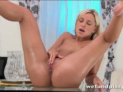 Hot blonde pees in a glass and makes a mess videos