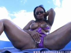 Black girl on a boat oils up her sexy body movies at adipics.com