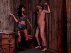 Bossy cowgirl whips her male slave in the barn movies at sgirls.net