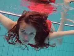 Teen in a pretty red dress slips into the pool movies at relaxxx.net