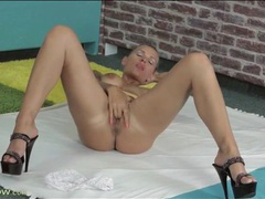 Inked beauty keeps her heels on as she masturbates movies