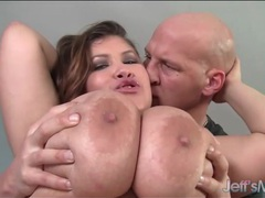 Erotically rubbing oil into her huge bbw tits videos