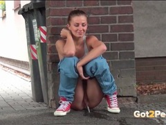 Sporty girl squats and pees on the pavement movies